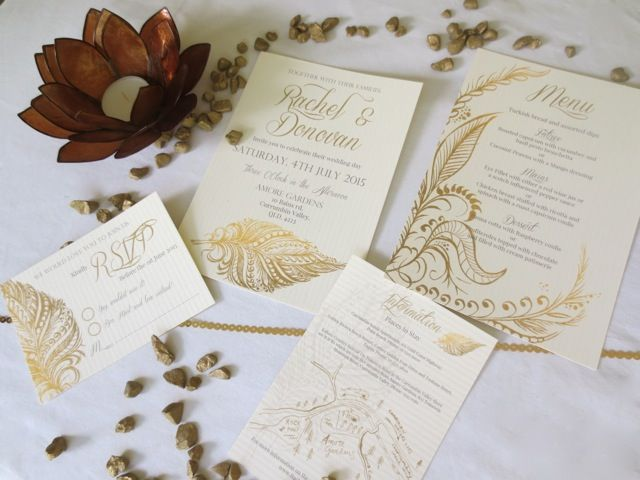 Wedding invitation design for Rachel and Donovan's elegant wedding. Beautiful gold invites featuring a feather design and script writing.