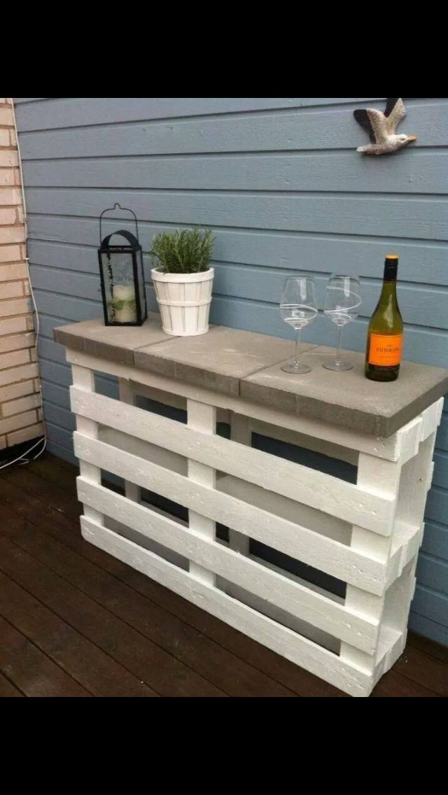 Two pallets, 3 concrete pavers and some white paint... Outside bar