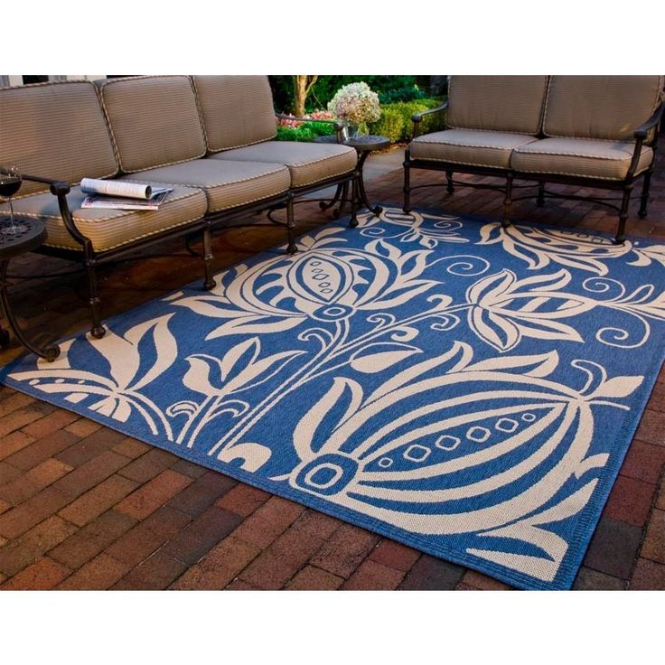 This transitional, indoor-outdoor area rug with its graphic floral design in natural and blue is sophisticated enough for the living room, yet weatherproof for the deck or patio. The fine-spun polypropylene resists water, fading, mold, and mildew.