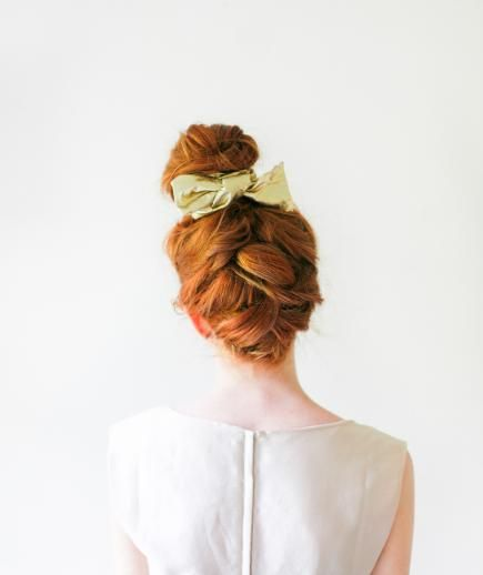 A loose and subtle braid that climbs up the back of your head makes a standard bun more appropriate for a day at the office or an evening out with friends. This simple trick is perfect for disguising a bad hair day and it'll get you props at the office for your style know-how.