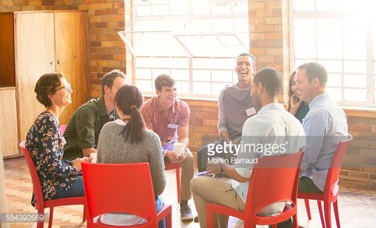 Stock Photo : People in circle enjoying group therapy session