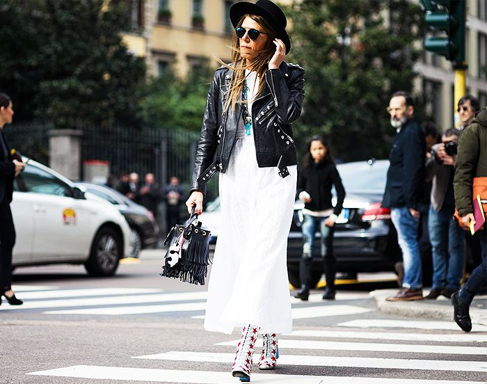 Anna Dello Russo pairs a studded leather jacket and white dress with leather star print boots by Sasint Laurent