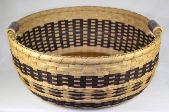 This gorgeous hand woven basket has so much detail and functionality! The double walled design offers different weaving on the inside and