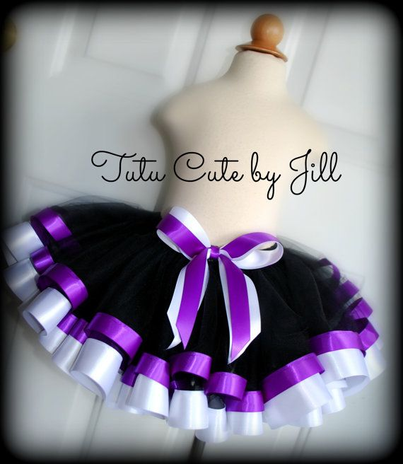 This black tutu is trimmed with yards and yards of luscious, wide dark purple and white satin ribbon in the 1 1/2 size.  Great for birthday