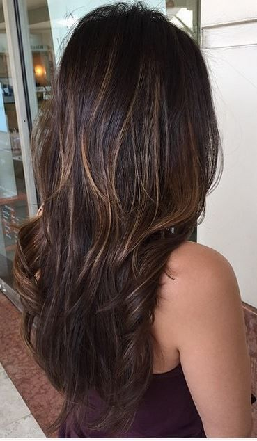 Shiny brunette with hints of balayage highlights