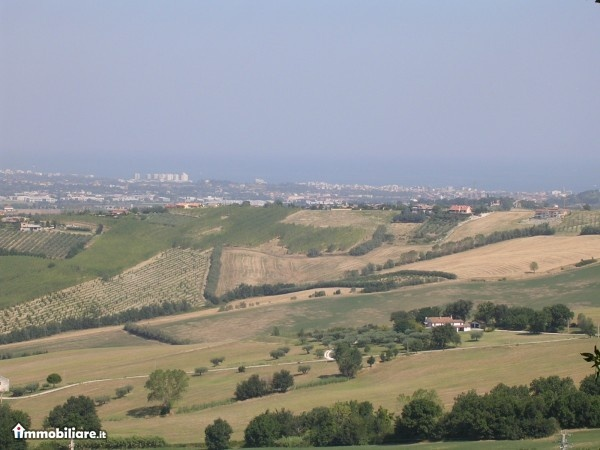 Tavullia Italy countryside with Adriatic Sea in background beyond Rimini