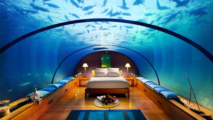 The Conrad Maldives. Lay back, relax and watch the fish in the sky swim by.