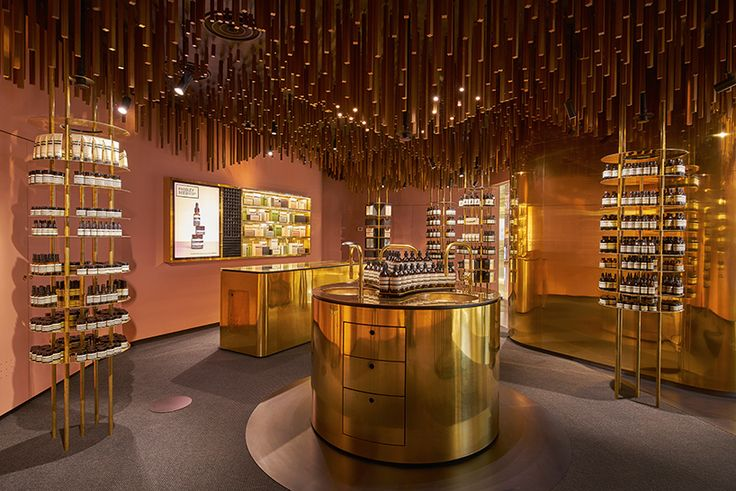 snøhetta suspends timber battens from the ceiling of singapore's aesop ION store