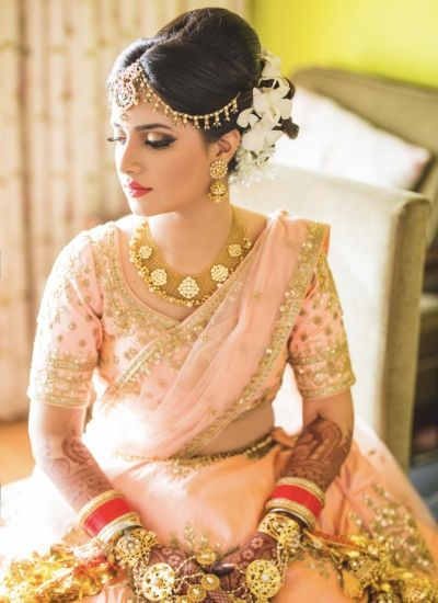 Bridal Portrait - Bride in a Peach and Gold Lehenga with Gold Jewelry | WedMeGood #wedmegood #indianbride #indianwedding #bridal #lehenga #peach #gold #bridalportrait #bridal #bride