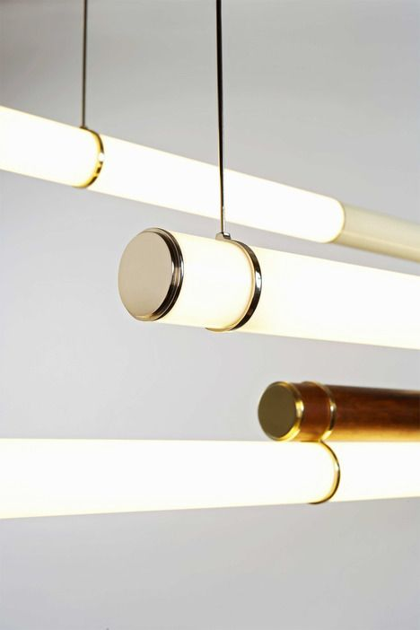 """Luminescent acrylic tubes are supported by brass and nickel hardware. Wood and powder coated steel sections conceal all the electronics. Mini Endless can be hung end-to-end, side-to-side, or overlapped with the addition of custom-made steel hardware. The possibilities are endless."""