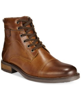 Distinguish your casual look with these stately, retro-inspired leather mid boots from Alfani. | Leather upper; man-made sole | Imported | Cap toe | Lace-up closure with metal eyelets | Padded footbed
