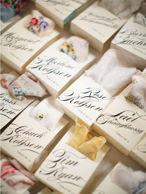 Handkerchief Seating Cards - not sure what to like more: the gorgeous calligraphy or the idea of giving each guest a vintage handkerchief :-)