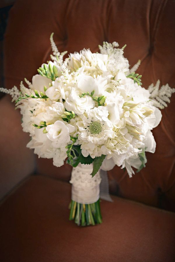 White monochromatic bouquet with Astilbe, Ranunculus, Scabiosa, Freesia, and Hydrangea