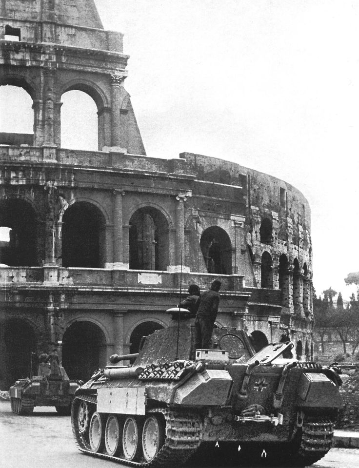 A column of German Panther tanks from Panzer-Regiment 4 approaches the Colosseum on the Via dei Fori Imperiali in Rome (February 1944).