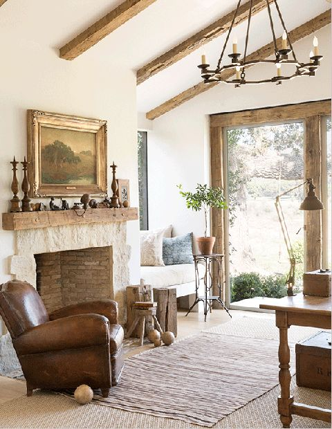 Personal mementos grace the mantel in Steve's office. Chandelier, Circa Lighting; vintage rug, Pierre Lafond; art, Sidney Yard.