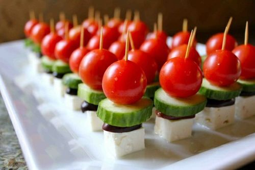 "Greek Salad Bites!  Toothpick w/ cherry tomato, cucumber slice, halved black olive, and cubed cheese (guessing it Feta..hence ""Greek"")"