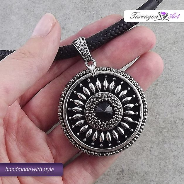 A unique statement necklace in shades of dark silver and black. Beautiful large pendant suspended on a thick faux leather cord with magnetic clasp. Combination of beaded and metal elements that...