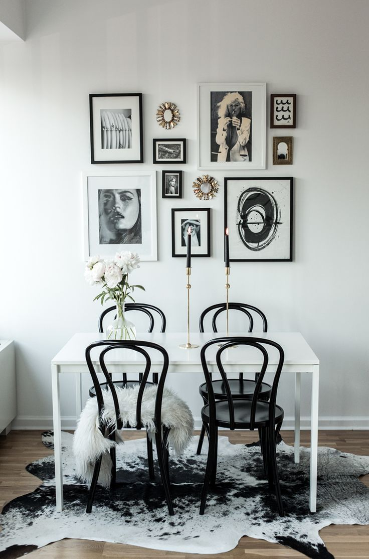 LOVE this. It's our current dining table. Get black chairs, tall gold candle sticks, black, gold, and white frame wall.