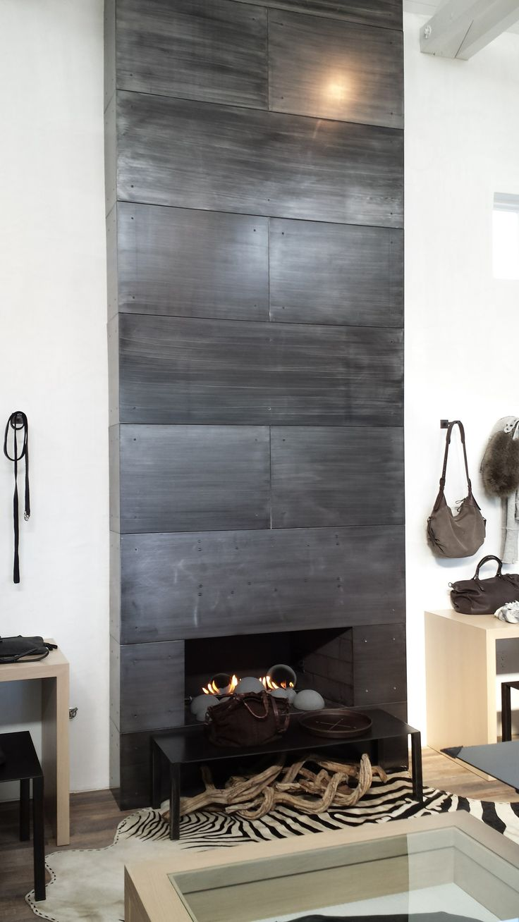 this is similar to our fireplace but ours will be out of zinc with nails on edge, will go full high of open ceiling