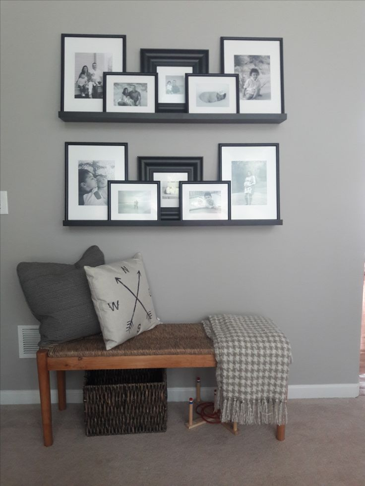 Picture ledge gallery wall and bench in living room hallway