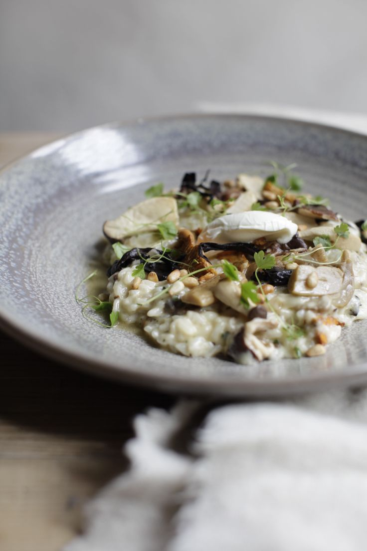 BLACK TRUFFLE & WILD MUSHROOM RISOTTO,celery leaf, toasted pine nuts, mascarpone cream