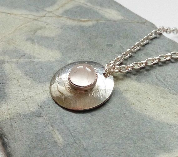 Check out this item in my Etsy shop https://www.etsy.com/uk/listing/516610438/delicate-round-sterling-silver-pendant