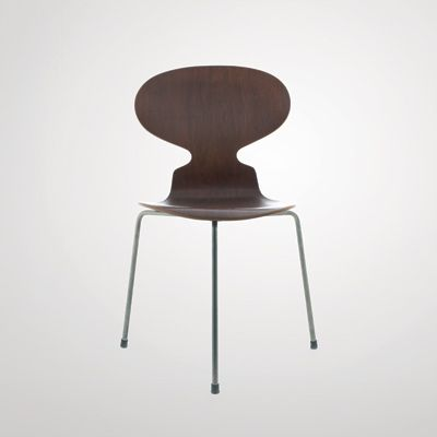 Arne Jacobsen: The Ant Chair- constructed of a singular piece of plywood, with steel legs. rubber dampers connect the layers tot he seat. 9 laminated layers. Stack-able.