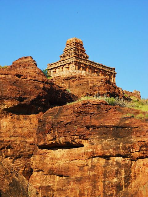 Badami. Looking up at the mid 7th century Upper Shivalaya Temple, which crowns the redrock outcropping and was once enclosed in defensive walls. The Chalukyas shifted from mostly cave temples to structural temples sometime around the beginning of the 7th century, making this a fairly early example.