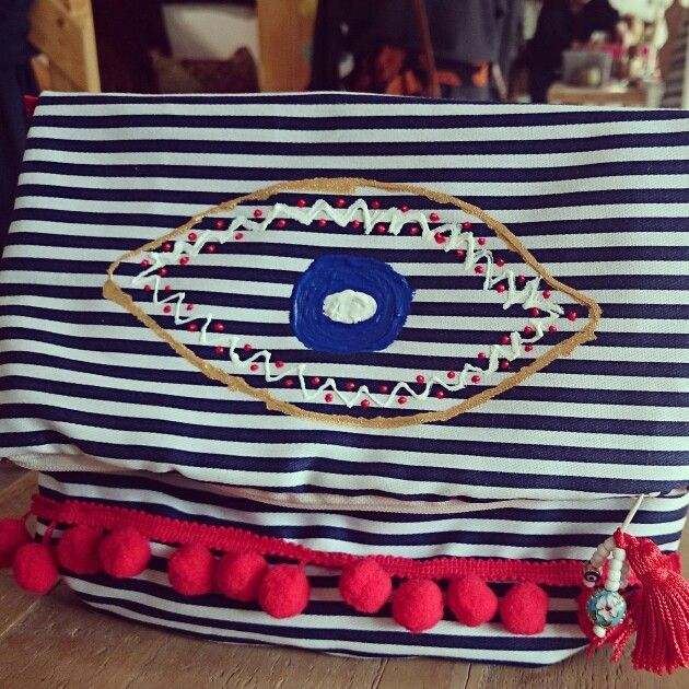 Bag, clutch with evileye and pompom by Frolic Stones