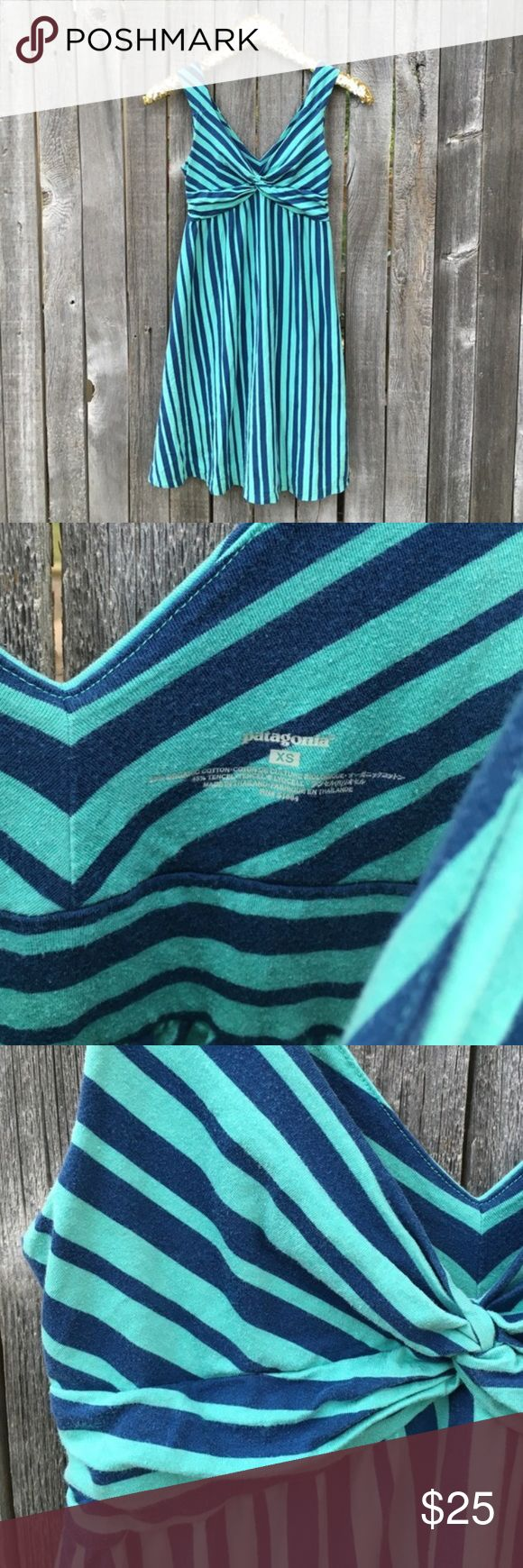 "{patagonia} Navy & Turquoise Striped Sundress XS EUC! A little bit of wash wear, barely noticeable. The most perfect dress. Comfortable, cute and classy! Transitions seamlessly under a cardi with boots for Winter, or alone with sandals in the summer! Flared A-Line, skater style skirt with empire waist. Feminine and trendy criss cross detail at bust. 14"" pit to pit, 35"" shoulder to hem length. Offers warmly welcomed! Patagonia Dresses Mini"