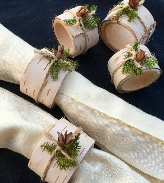 """This listing is for 8 napkin rings made of wood, covered with birch bark and decorated with preserved pine, Hemlock cones and twine. They measure about 2.5"""" across. I ship next business day by US Post"""