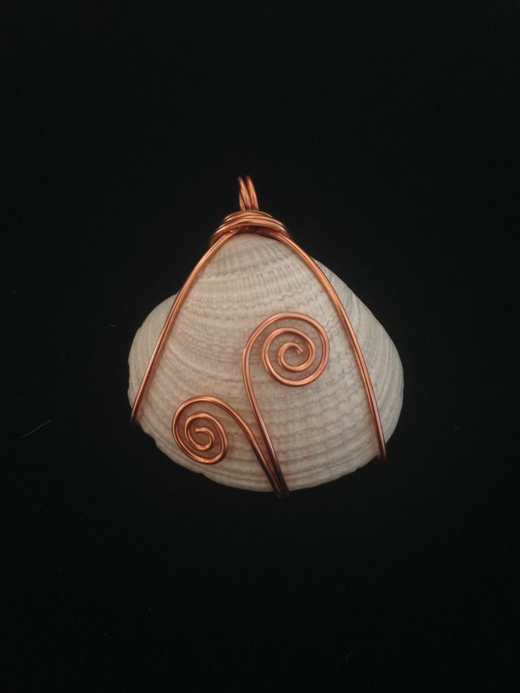 Wire-wrapped seashell pendant.