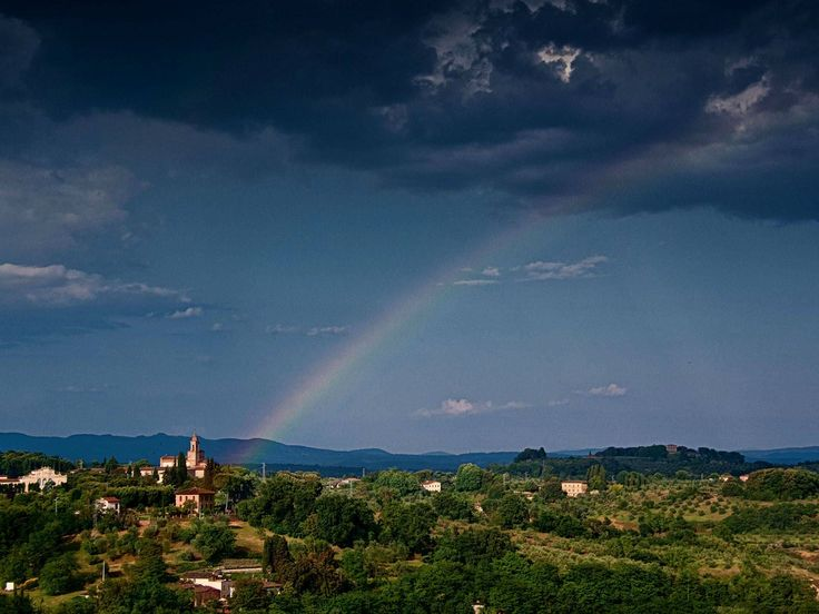 Climate: In the image above, you see a rainbow across the sky after a rainy day in Italy. Although it doesn't rain on a daily basis in Italy, the country has a history of floods. In 1966, there was a major flood in Florence, Italy. It killed many people, and did damage to many houses and buildings. The weather in Italy, though, is usually not too hot or cold; it's usually temperate.