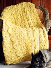 Reversible Cabled Afghan Pattern from AnniesCatalog.com -- There's no wrong side to this afghan. Knit in Lily's signature reversible cables, it works up quickly in worsted weight yarn on size 11 needles.