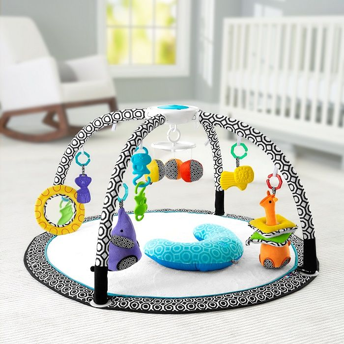 """Jonathan Adler Crafted by Fisher-Price Sensory Gym --  This will be baby's new favorite place to play! With music and lights, extra-large mat, premium fabrics, tummy wedge, and calming vibrations, helps exercise developmental skills. The extra-large mat is full of big fun, with nine linkable toys and a variety of textures and sounds to discover. Newborns can lay and play, watching the """"dancing"""" colored lights and mobile overhead and batting at the colorful toys."""
