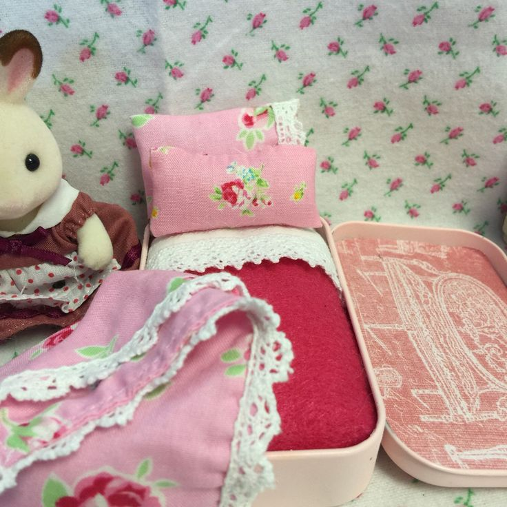 A personal favorite from my Etsy shop https://www.etsy.com/listing/271802404/calico-critters-travel-bed-and-bedding
