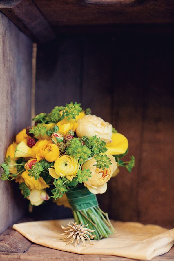 yellow. green. brown. flowers. bunch. bouquet. shelf. wood. leaning.| RP »