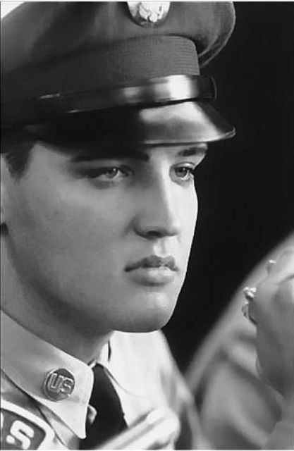 Photo by Alfred Wertheimer:  Question : Elvis,What was the author of the book you were carrying,when you got of the train? Elvis : I had just gotten the book,I don't know,One of the boys gave it to me on the train,and the title of the book was 'Poems that touch the heart' Question : Have you had a chance to read it? Elvis : Yes ma'am ,I read a couple of poems in it,I read one in particular called 'Should you go first',which is a beautiful poem,the author was unknown.