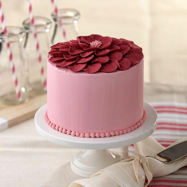 Frilly wild rose petals turn this plain cake into a very special treat for Mother's Day or any spring party. Learn to pipe perfect petals at a Wilton Method Class on @Craftsy.
