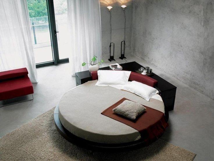 chambre coucher contemporaine avec lit rond mur en bton et tapis beige