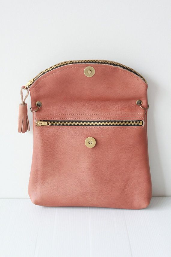 "Adjustable clutch/ fun messenger bag in pink leather. @Katie Moore $49.00  Buttom widht : 8.5 "" or 20.5 cm.  Height : 7 "" or 17.5 cm.  Strap long : can adjustable to 45.5"