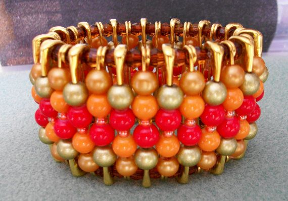 Here is a beefy stretch safety pin bracelet, designed to be as comfortable as wearing nothing at all, despite the larger glass beads! All pins