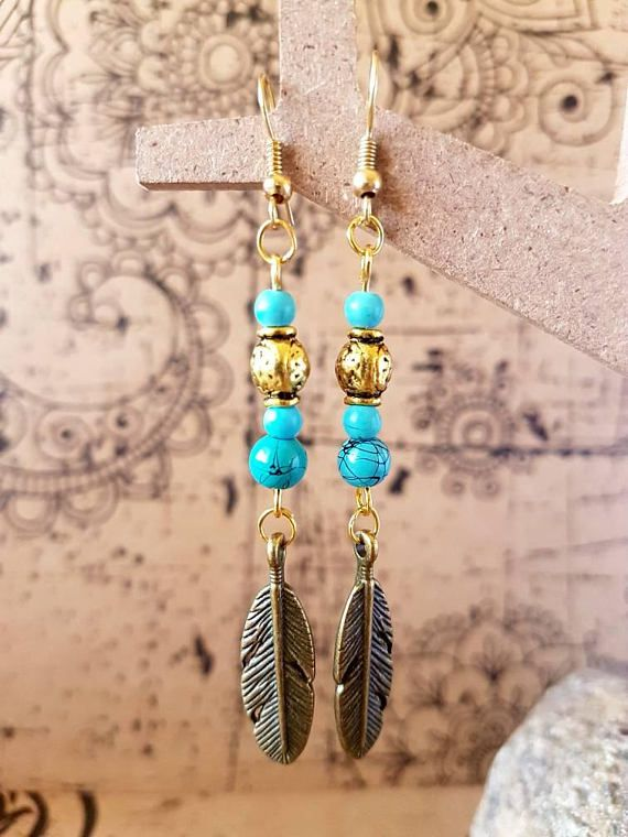 Check out this item in my Etsy shop https://www.etsy.com/au/listing/547565513/turquoise-and-gold-feathered-earrings