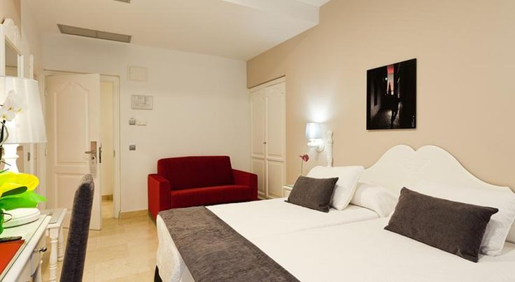 Hotel Carlos V Toledo Hotel Carlos V is located next to the Alcázar Fortress and Toledo's famous Cathedral. Most rooms have excellent views of this world heritage city and all are equipped with air conditioning.