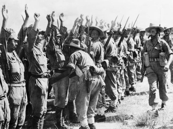 Japanese Prisoners of War: Soldiers of the Royal Garhwal Rifles search Japanese soldiers at Kuala Lumpur, Malaysia. The Burma Campaign 1941-1945