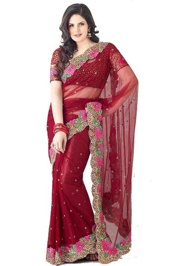 Ravishing Zarine Khan Maroon Net Sare  Fabric: NetColor: Maroon More details  Reference : VLR5796 http://valehri.com/sarees/440-ravishing-zarine-khan-maroon-net-sare.html