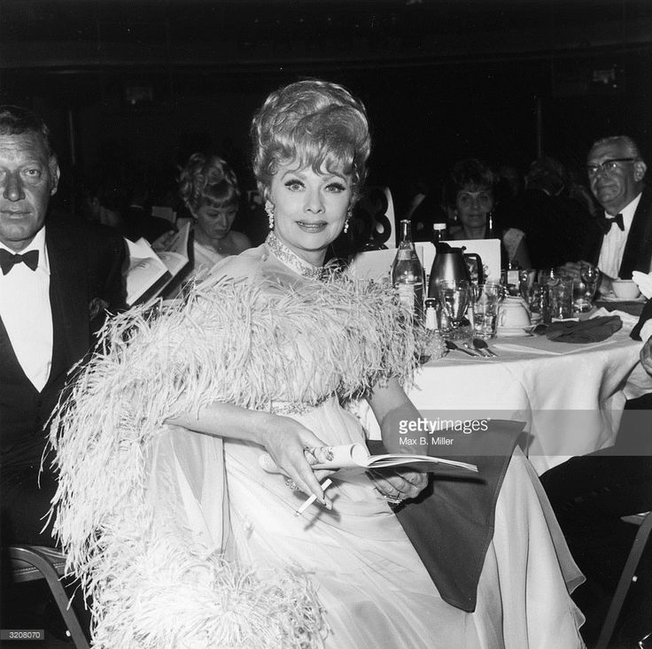1968 American Actor Lucille Ball Sits At A Dinner Table With Her Second Husband Gary