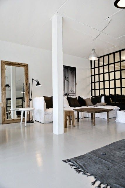 nice rustic mirror, white floor, large black framed divider/wall and THE WHITE BEAM