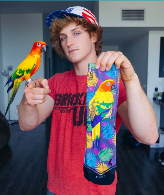 Logan Paul with his first peace of merch, Mavrick socks!