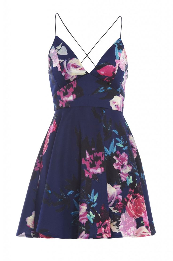 This cute skater dress is a must have for the Summer season. The string straps, cross over back and plunging neckline add a glamorous touch while the floral print and flared out skirt keep it cute and feminine. Perfect paired with flats or heels!          *PRINT POSITION MAY VARY     Approx length from top of shoulder strap to hem:79cm Fabric composition: 92% Polyester  8% Elastane   Colour: NAVY